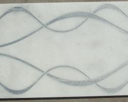 Mármol blanco decorado con plata